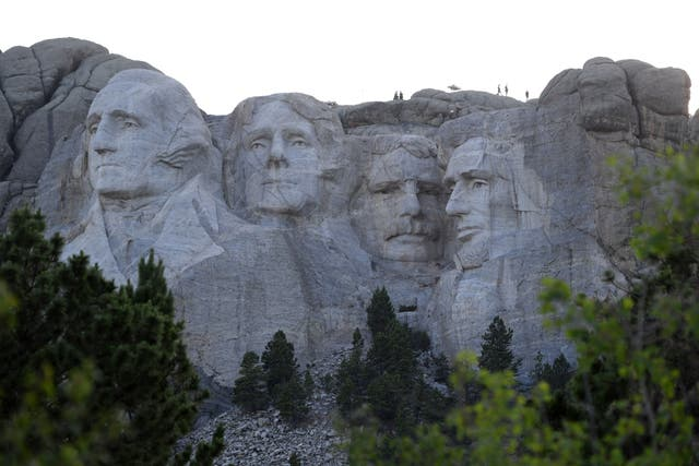 U.S. presidents George Washington, Thomas Jefferson, Theodore Roosevelt and Abraham Lincoln are represented at the Mount Rushmore National Memorial in Keystone, South Dakota, with this image being taken during a visit from former President Donald Trump on 3 July, 2020. Schools named after Washington and Lincoln are set to have their names changed.
