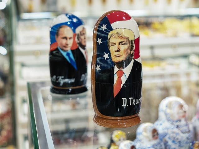 A Moscow shop display shows Matryoshka dolls featuring Vladimir Putin and Donald Trump.