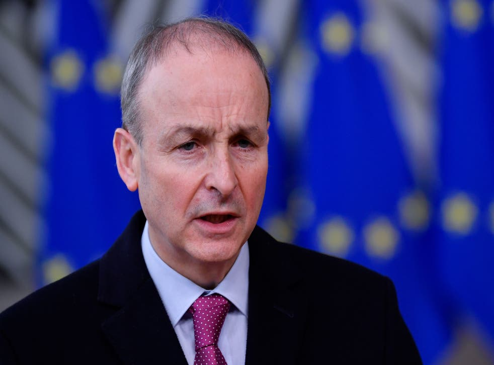 Ireland's Prime Minister Micheál Martin speaks to the press as he arrives at the EU headquarters' Europa building in Brussels on 10 December, 2020, prior to a European Union summit. The premier has urged calm in the race to vaccinate populations around the world.