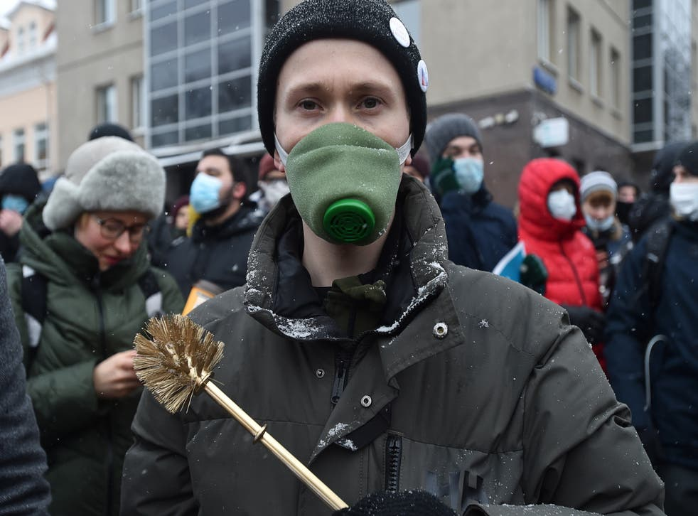 A demonstrator holds a toilet brush during a rally in support of jailed Russian opposition leader Alexei Navalny in Moscow