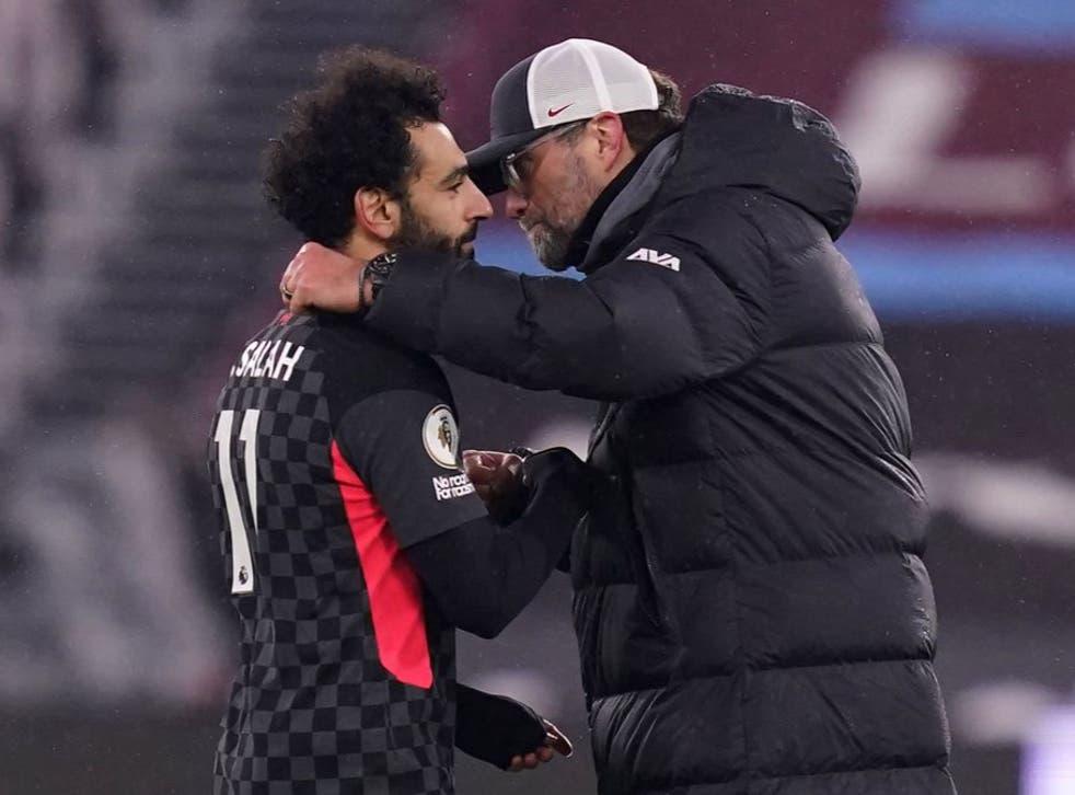 <p>Mohamed Salah embraces Jurgen Klopp</p>