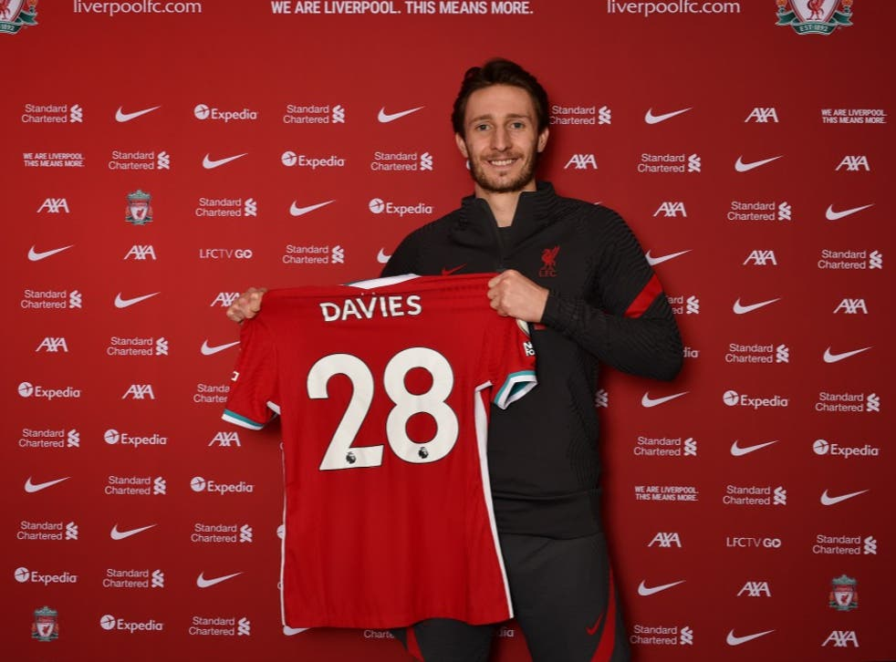 <p>Davies poses with the No 28 shirt after signing from Preston</p>