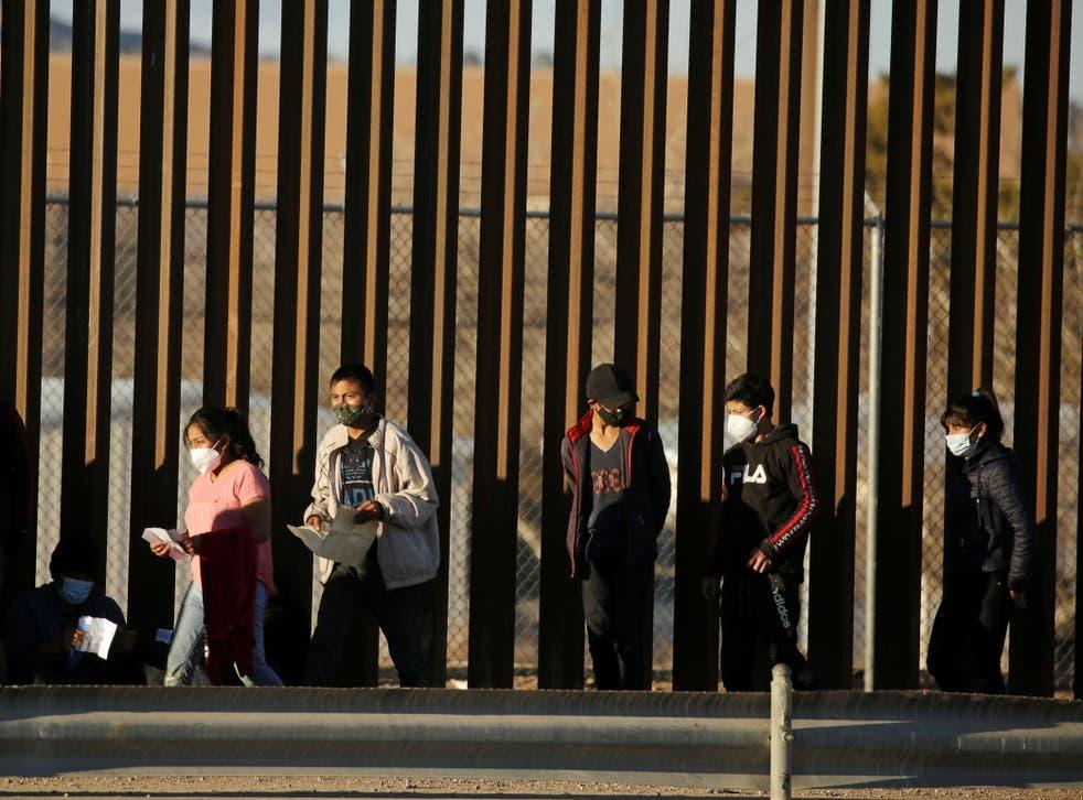 People seeking asylum cross into El Paso, Texas from Ciudad Juarez, Mexico on 22 January. President Joe Biden has sought to undo a core of Donald Trump's immigration agenda.