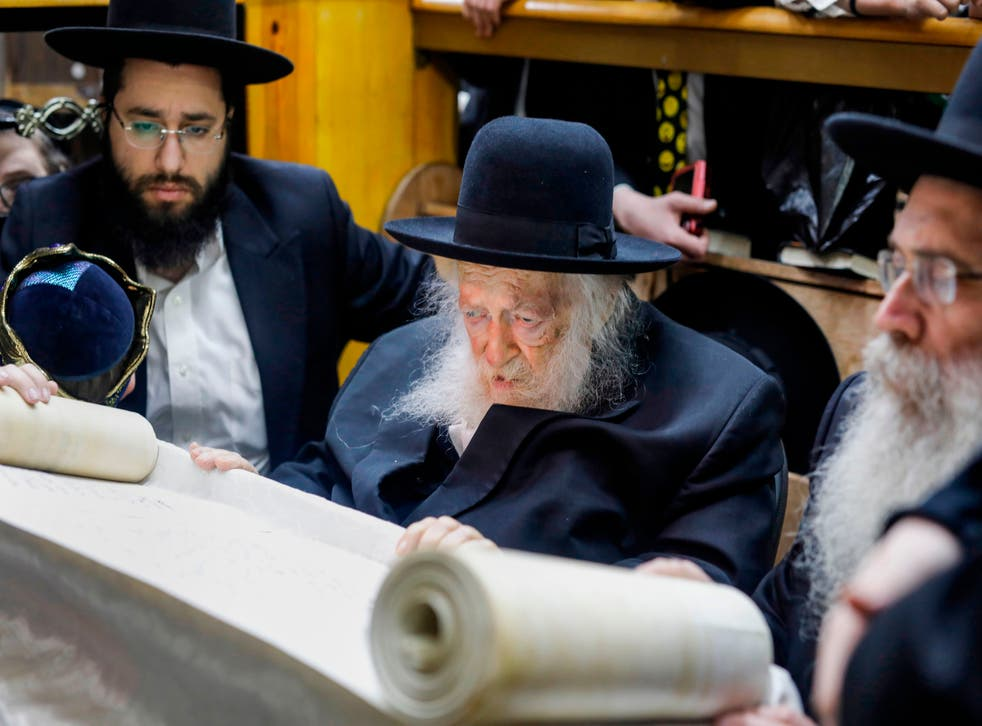 <p>On holiday: Rabbi Chaim Kanievsky reads the book of Esther in a rare visit to a local synagogue for the feast of Purim two years ago</p>