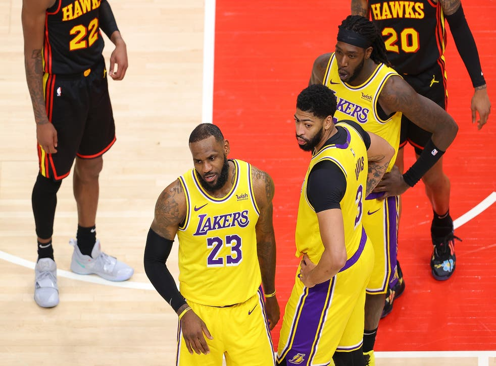 LeBron James of the Los Angeles Lakers reacts to a fan courtside during the second half against the Atlanta Hawks at State Farm Arena