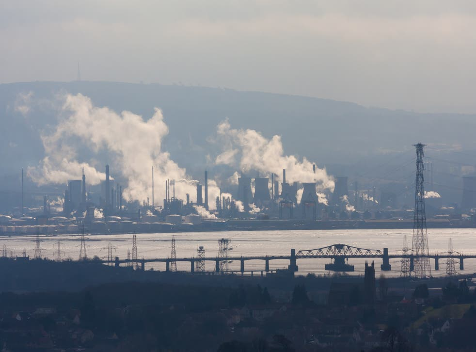 Plumes of smoke rise over the Firth of Forth in Scotland. Air pollution may damage almost every cell in the human body