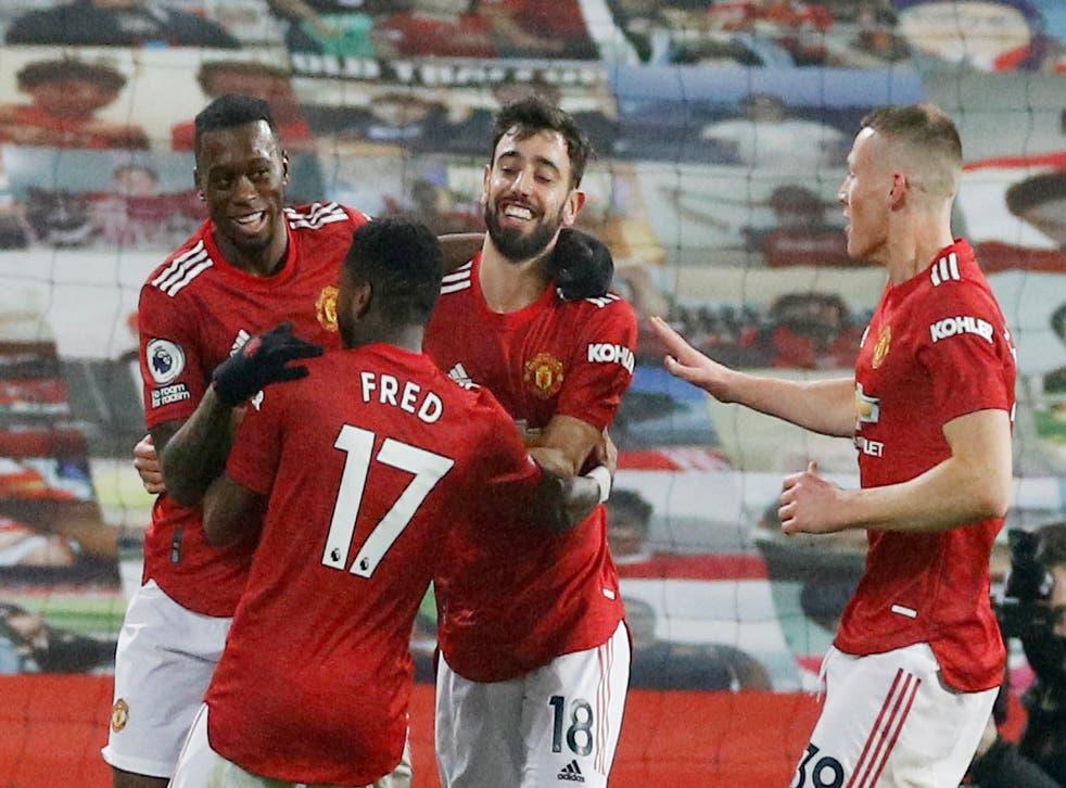 Aaron Wan-Bissaka celebrates with his United teammates