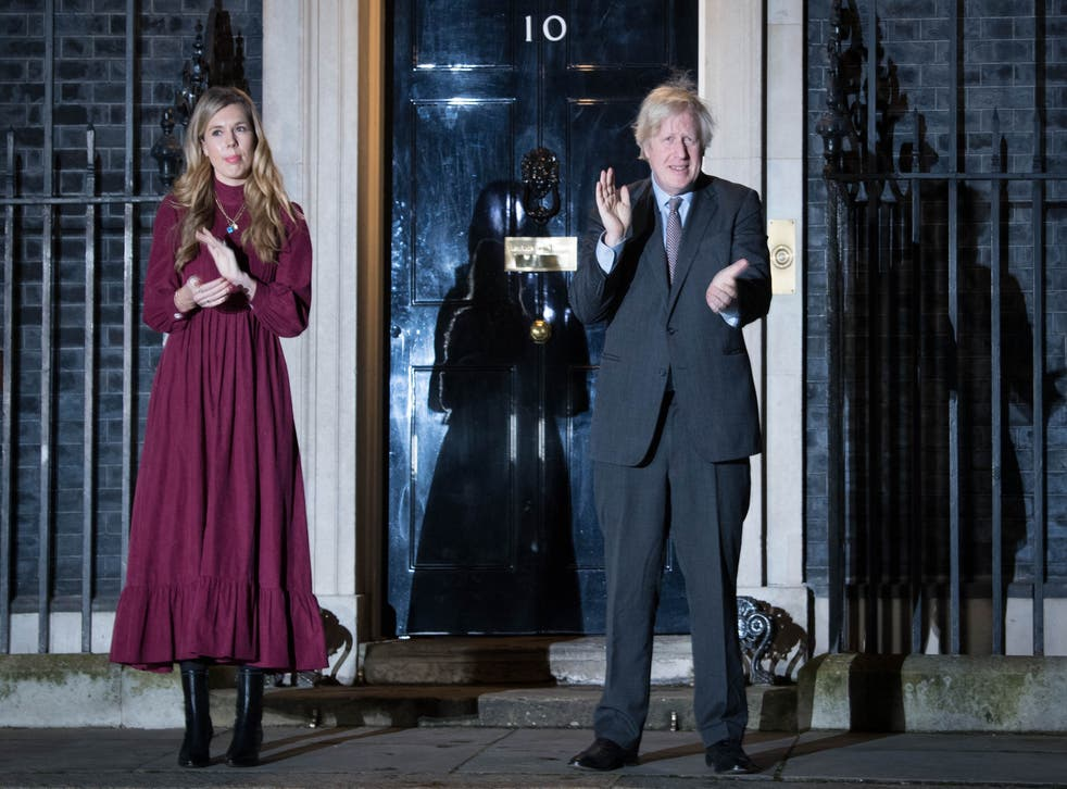 <p>Boris Johnson and his partner Carrie Symonds clap outside 10 Downing Street on Wednesday</p>