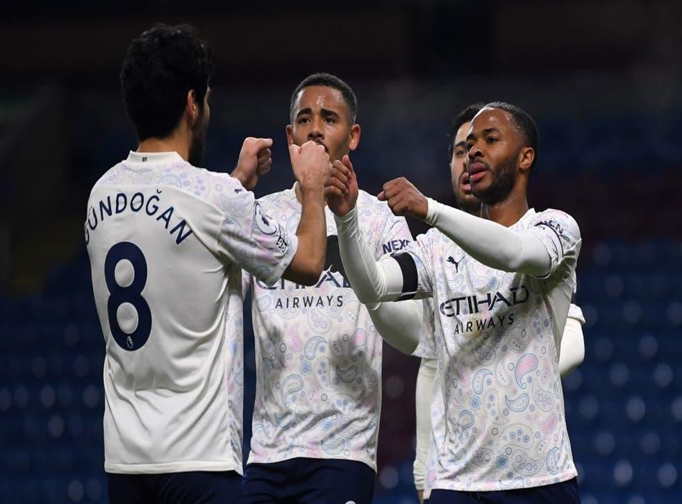Raheem Sterling celebrates scoring with Gabriel Jesus and Ilkay Gundogan
