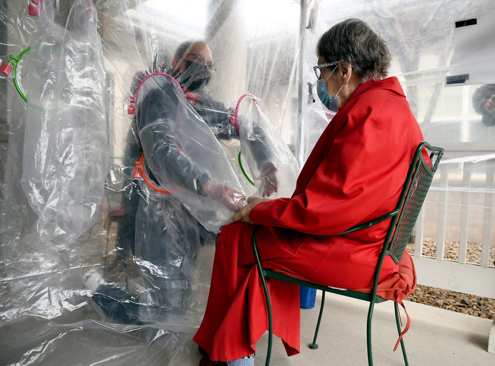 APTOPIX Virus Outbreak Hug Tent