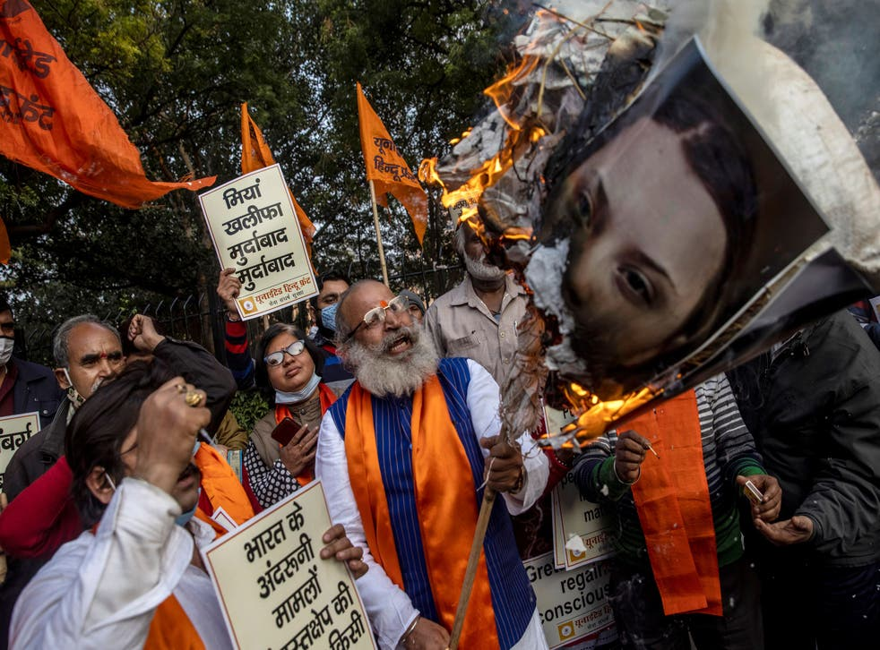 <p>Activists from United Hindu Front burn an effigy depicting climate change activist Greta Thunberg to protest against celebrities commenting in support of protesting farmers</p>