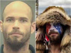 QAnon Shaman pictured without horns and face paint in mugshot, as he's moved to jail with organic food