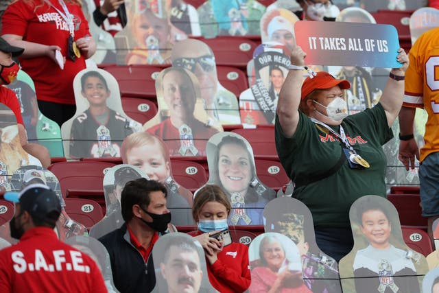 Fans sit in the stands among cardboard cutouts before Super Bowl LV between the Tampa Bay Buccaneers and the Kansas City Chiefs at Raymond James Stadium