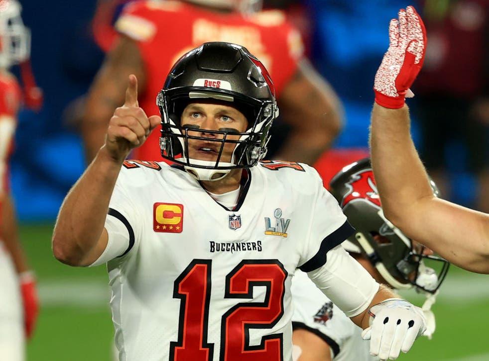 Tom Brady celebrates a 27-yard touchdown run by Leonard Fournette