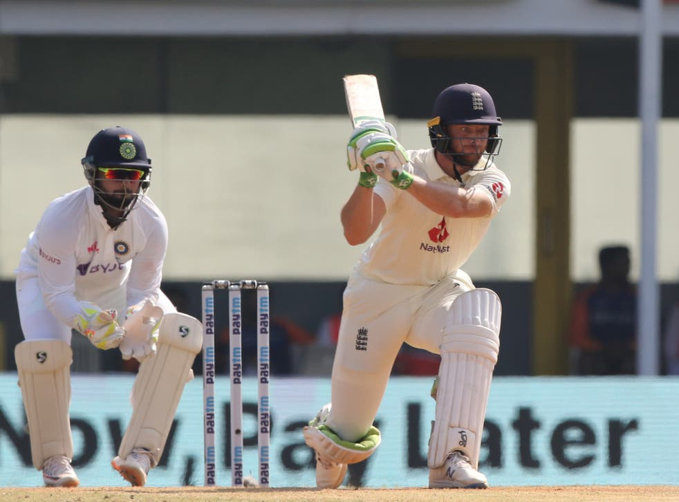 England's Jos Buttler (right) in action on day four of the first Test in India