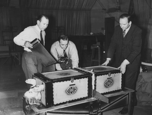 <p>Grate news: Brian Johnston broadcasts on the BBC's Home Service in 1949 while sawing</p>