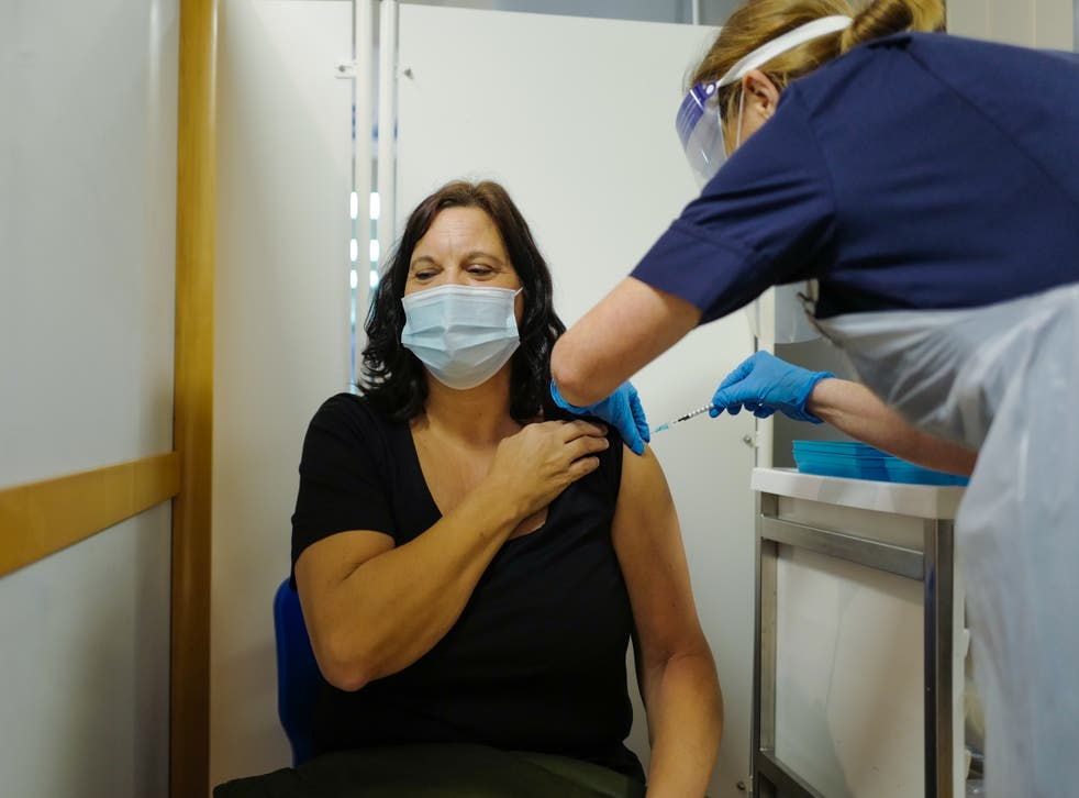 <p>A woman receives a vaccine dose at the Royal Cornwall Hospital on 9 December 2020</p>