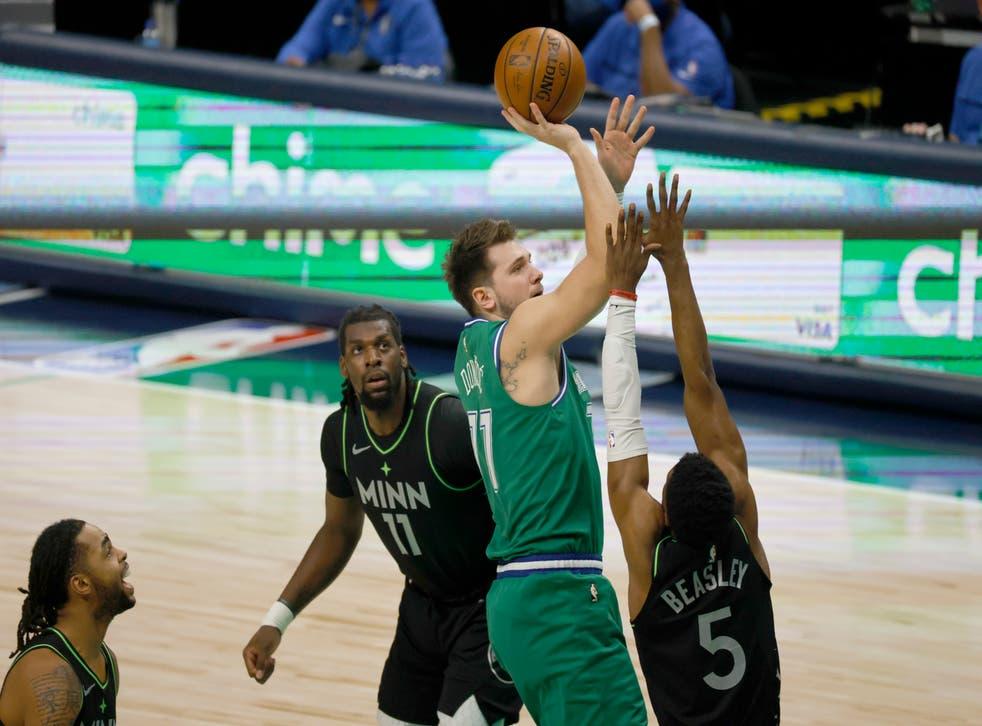 Dallas Mavericks guard Luka Doncic (77) shoots over Minnesota Timberwolves center Naz Reid on 8 February 2021