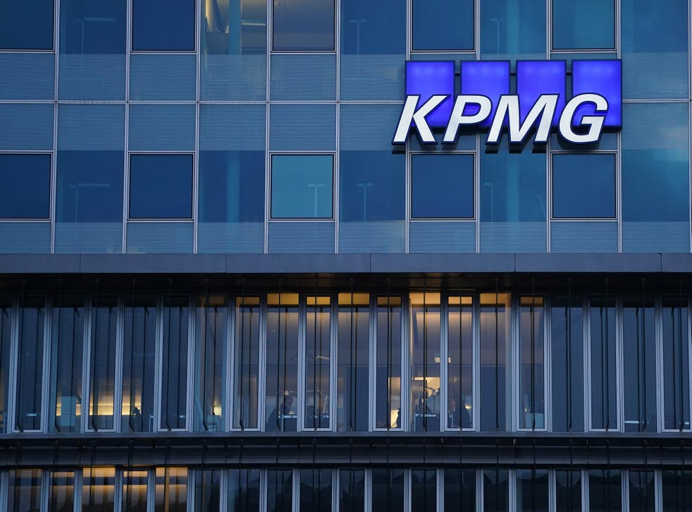 The logo of KPMG, a multinational tax advisory and accounting services company, hangs on the facade of a KPMG offices building on January 22, 2021 in Berlin, Germany