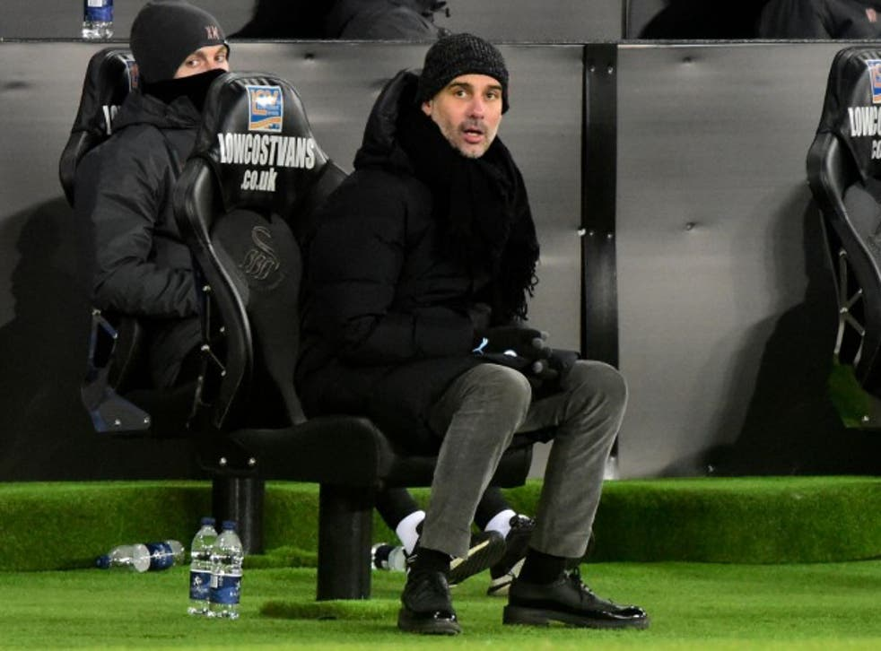<p>Guardiola watched his side set another record on Wednesday night</p>