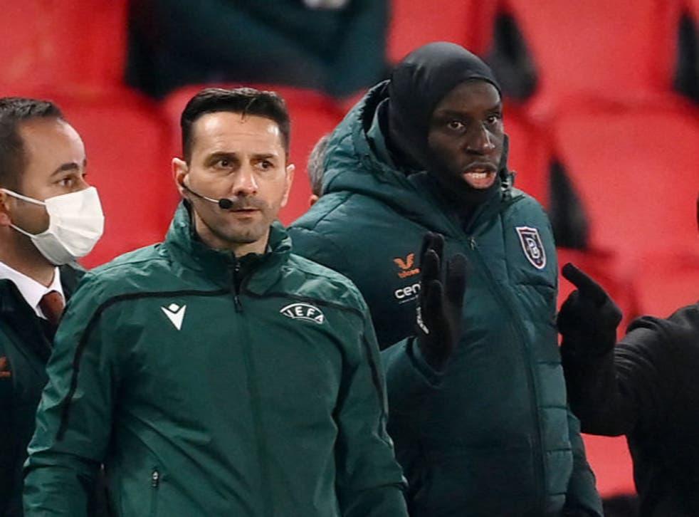 <p>Romanian fourth official Sebastian Coltescu and Istanbul Basaksehir forward Demba Ba</p>