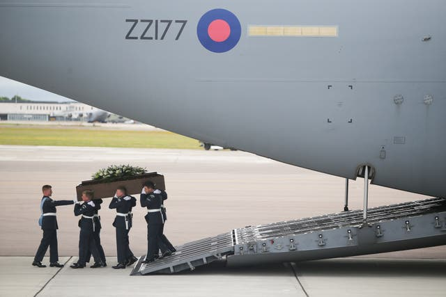 <p>The coffin of Trudy Jones, one of the victims of the 2015 terrorist attack in Tunisia, arriving in the UK</p>