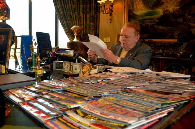 A stack of 'Hustler' back copies rest atop Larry Flynt's desk in October 2011.