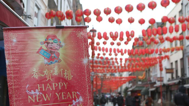 Lanterns hang across the street to celebrate the Chinese Lunar New Year which marks the Year of the Ox, in Chinatown, central London, during England's third national lockdown to curb the spread of coronavirus.