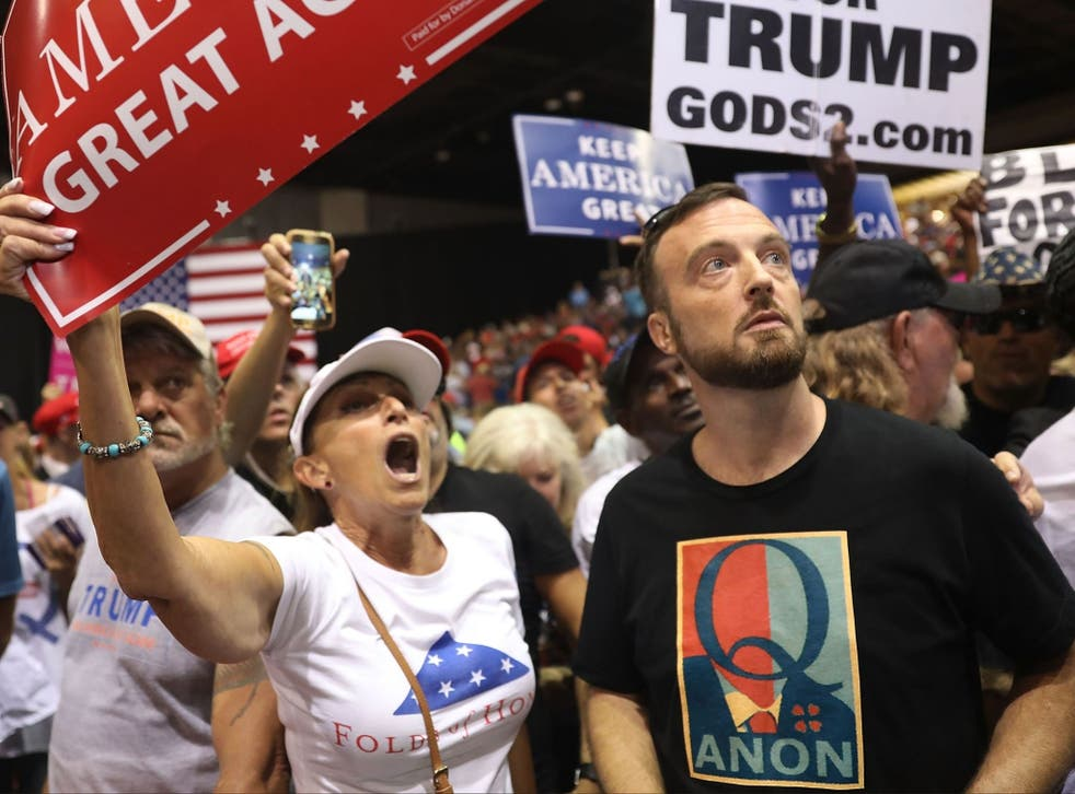 <p>A man wearing a Q Anon shirt attends a rally for President Donald Trump at the Florida State Fair Grounds Expo Hall on July 31, 2018 in Tampa, Florida. </p>