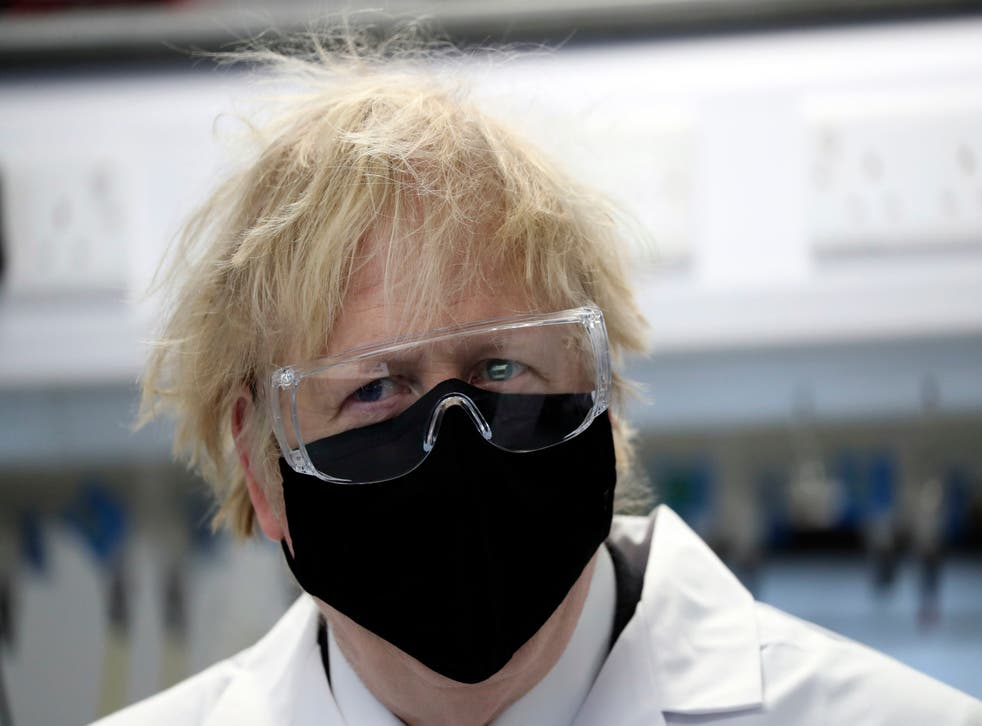 Boris Johnson, wearing a face mask, during a visit to a pharmaceutical manufacturing facility in Stockton-on-Tees