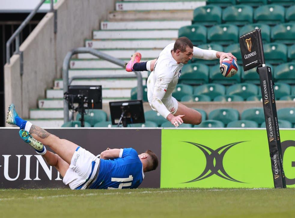 Jonny May of England dives over Luca Sperandio of Italy to score
