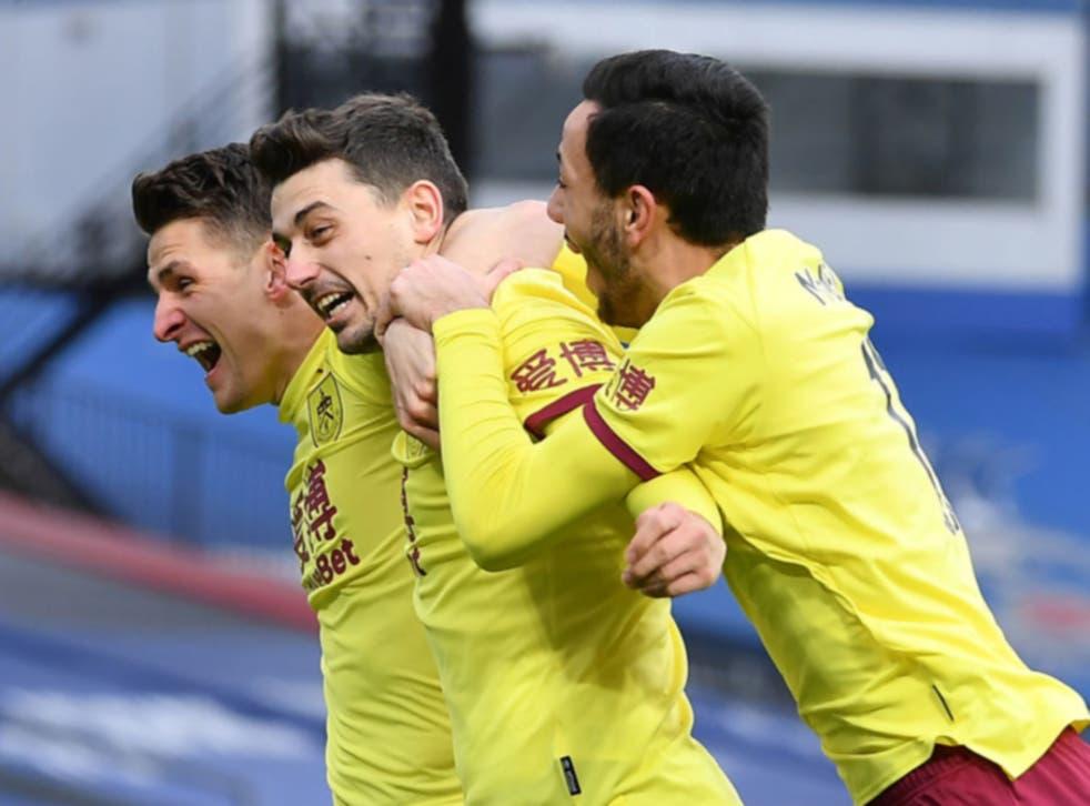 Matthew Lowton celebrates with teammates