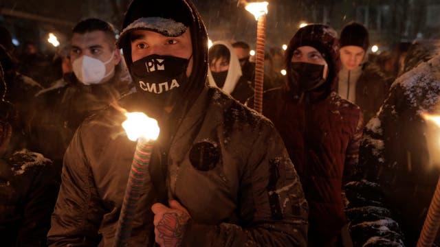<p>Partidarios vestidos de oscuro del grupo Unión Nacional Búlgara acudieron en masa a una plaza central.   </p>