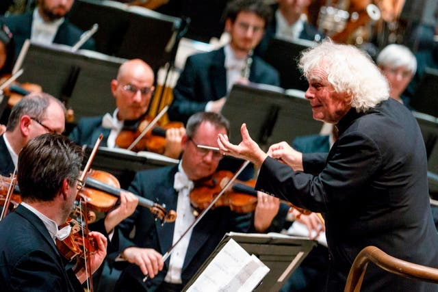 <p>Simon Rattle conducting his first concert as head of the LSO at the Barbican in 2017</p>
