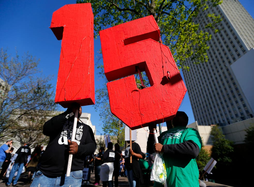 <p>Workers lead a Fight for $15 march in Memphis, Tennessee in 2017.</p>