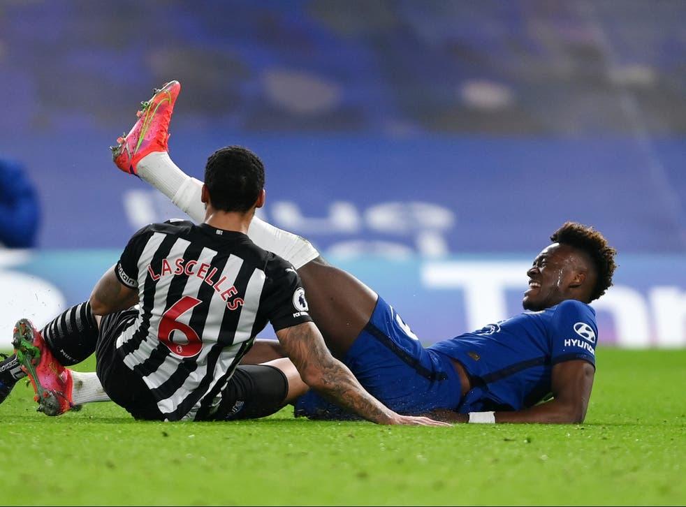 Jamaal Lascelles tackles Chelsea striker Tammy Abraham