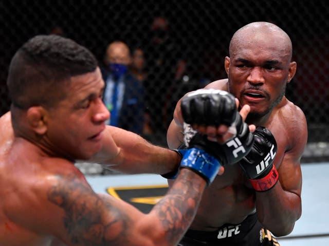 Kamaru Usman (right) stopped former team-mate Gilbert Burns at UFC 258
