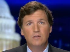 Tucker Carlson calls QAnon supporters 'gentle' patriots a week after suggesting the conspiracy didn't exist