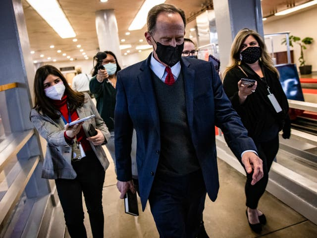 <p>Senator Pat Toomey (R-PA) walks through the Senate subway at the conclusion of former President Donald Trump's second impeachment trial February 13, 2021 in Washington, DC</p>
