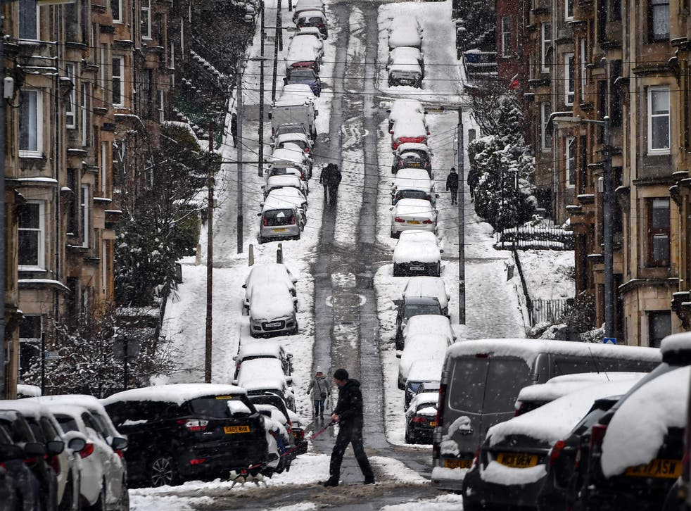 Gardner street in Glasgow as snow blankets the city. The UN's Cop26 climate conference is due to take place in the Scottish city in November