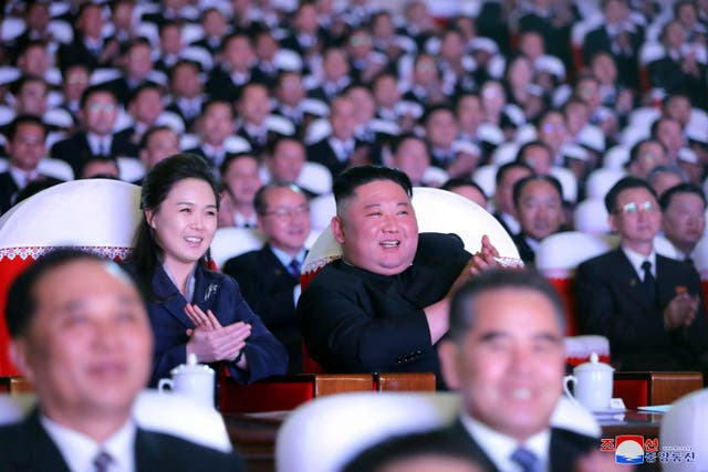 <p>North Korean leader Kim Jong-un and his wife Ri Sol-ju watch a performance marking the birth anniversary of Kim Jong-il in Pyongyang</p>