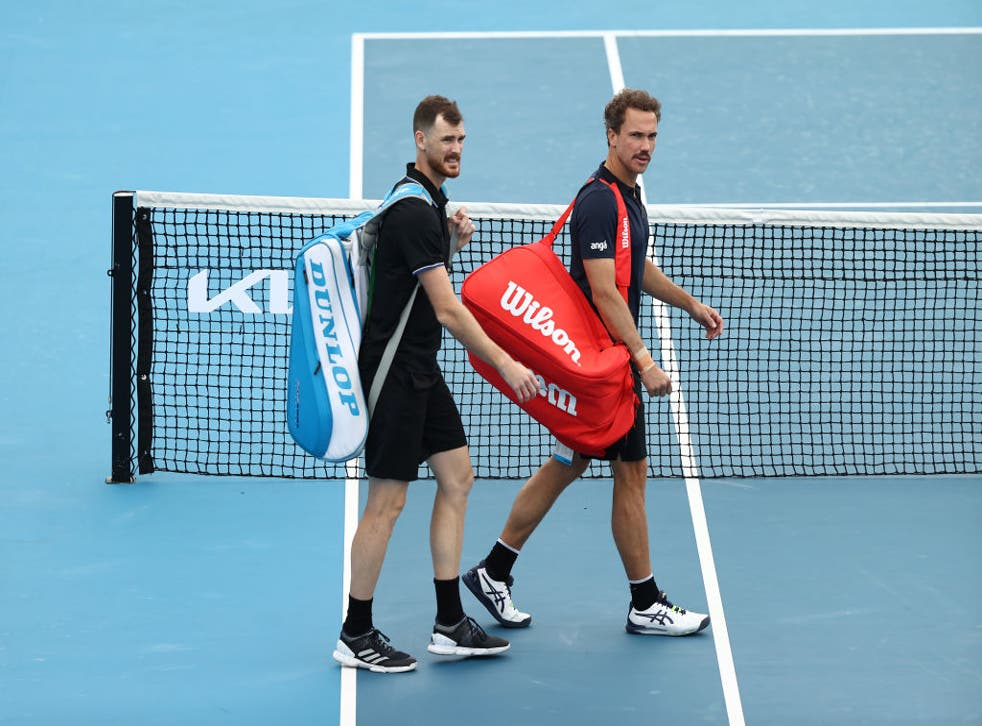 <p>Jamie Murray of Great Britain and Bruno Soares of Brazil walk off the court</p>