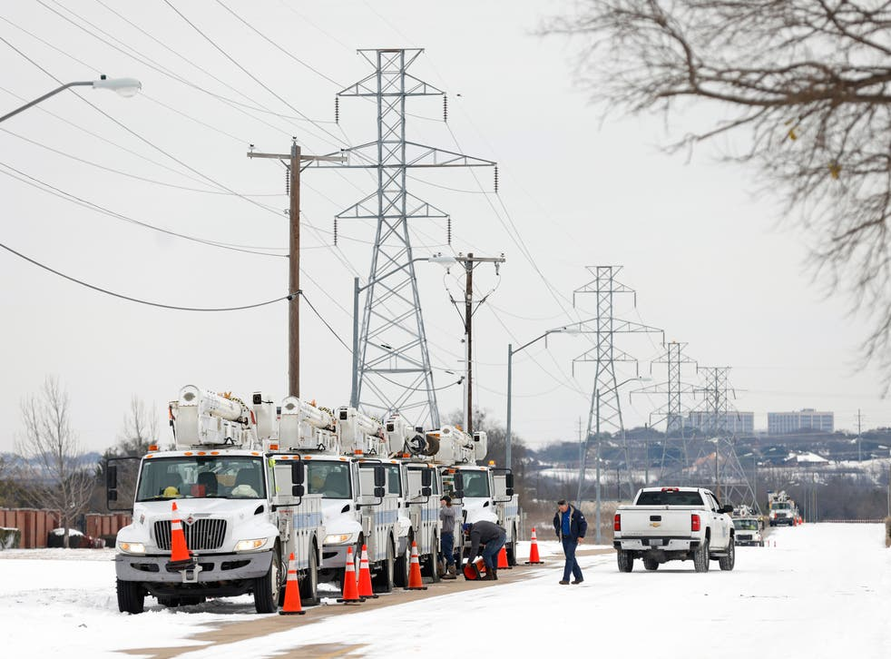 Pike Electric service trucks line up after a snow storm on 16 February, 2021 in Fort Worth, Texas