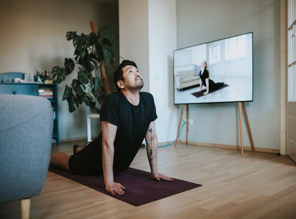 <p>Man does exercise in his living room</p>