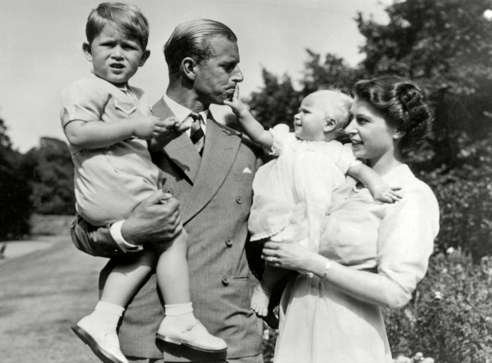 <p>Queen Elizabeth II and the Duke of Edinburgh holding Prince Charles and Princess Anne, 1952</p>