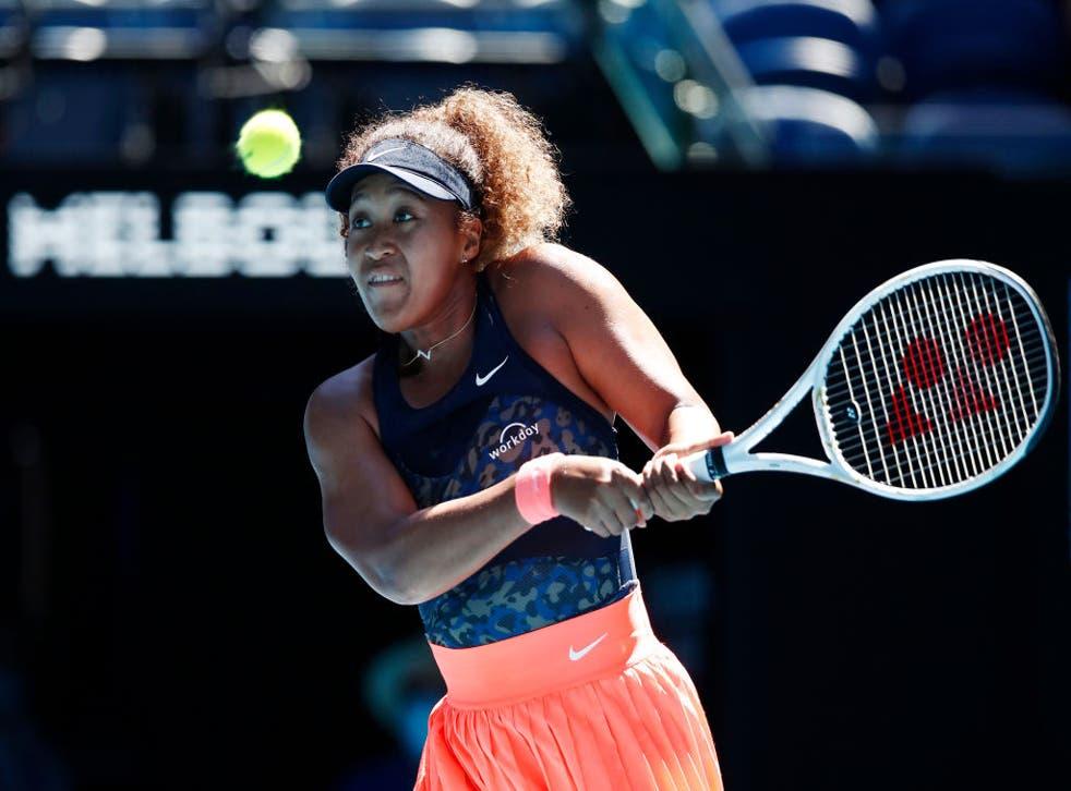 <p>Naomi Osaka plays a backhand against Serena Williams</p>