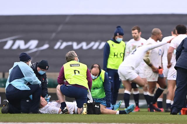 <p>Jack Willis receives medical treatment during the Six Nations match against Italy at Twickenham</p>