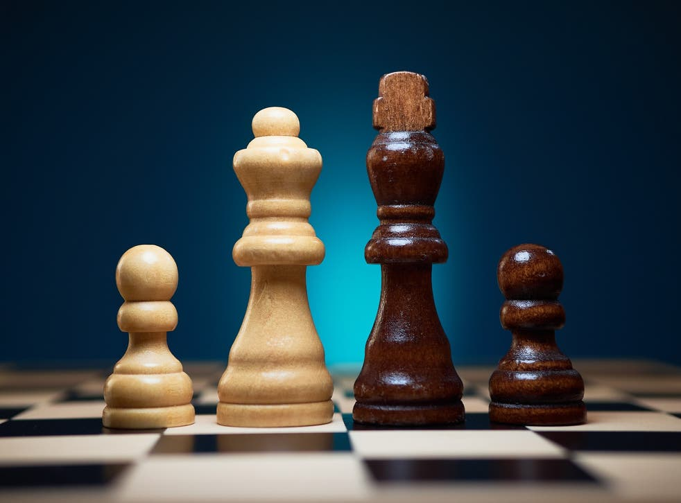 Popular chess channels on YouTube have faced temporary restrictions over suspected misconceptions about terms like 'black against white'