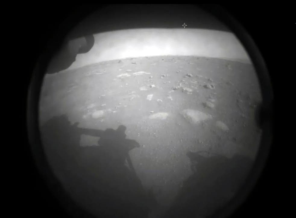 <p>Images from Nasa's Perseverance rover as it landed on the surface of Mars</p>