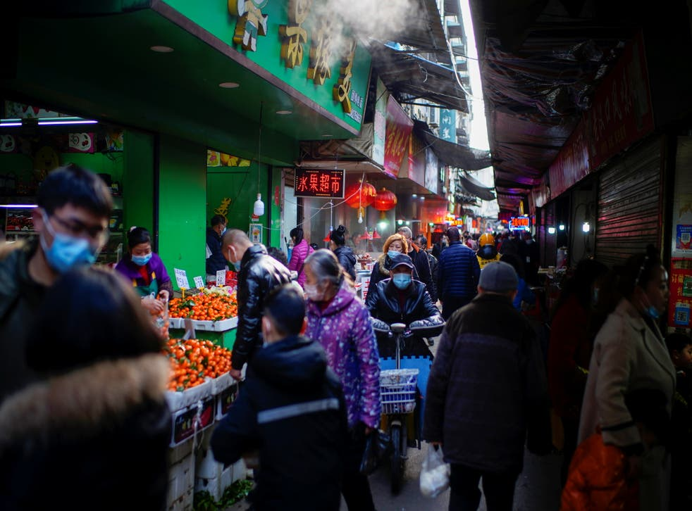 <p>Food market in Wuhan, China, in February 2021</p>